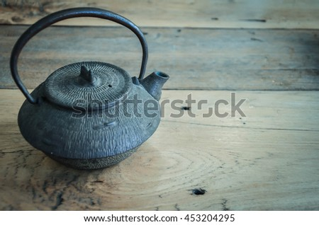 old coffee pot on wooden table