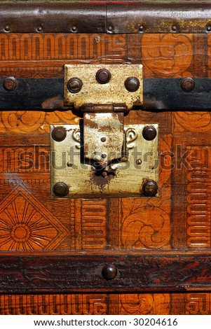 Old coffer with metallic lock.