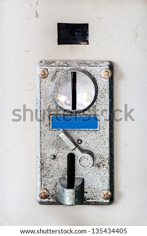 Old coin box of the automatic washing machine - stock photo