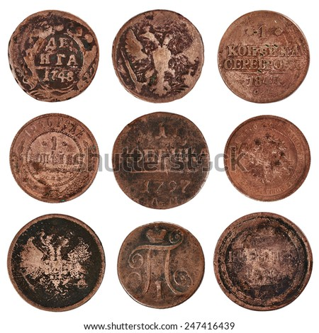 Old coins isolated on white background - stock photo