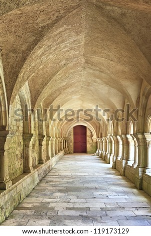 Old colonnaded closter in the Abbaye de Fontenay in Burgundy, France - stock photo