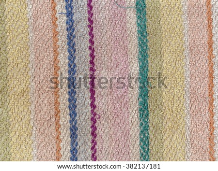 Old color bath towel texture with stripes. Background and texture. - stock photo