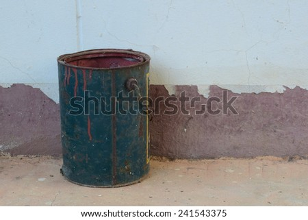 old color bucket on ground.color inside can not use - stock photo