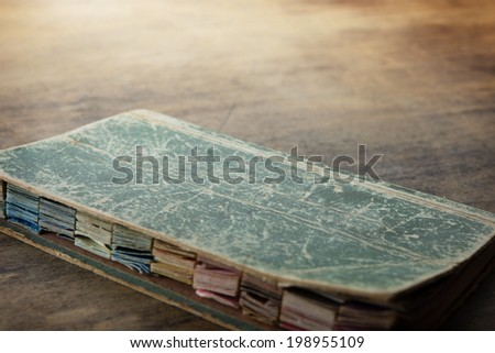 Old color chart or color palette booklet on a grungy old table.  - stock photo