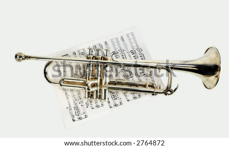 Old color trumpet on sheet music - stock photo