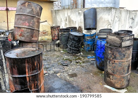 Old colored barrels for oil products. Empty rusted.
