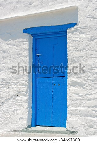 Old colored door from a house located in Sifnos island Greece - stock photo