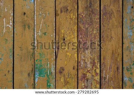 Old, colored fence - stock photo
