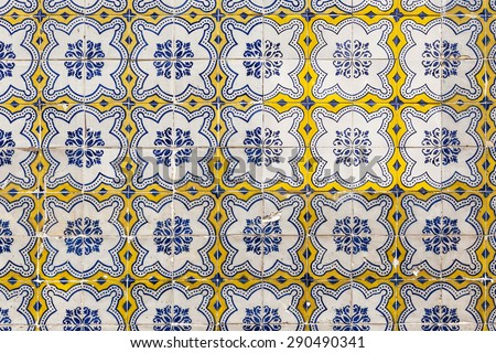 Old colorful azulejos on the building's exterior in Lisbon, Portugal. It is a form of Spanish and Portuguese painted tin-glazed ceramic tilework. - stock photo