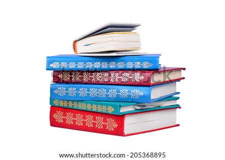Old colorful books isolated on white background - stock photo