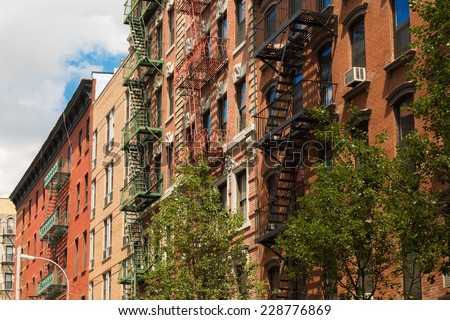 Old colorful buildings with fire escape in Little Italy, New York City, USA - stock photo