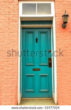 Old colorful colonial door with lantern found in Frederick, Maryland - stock photo