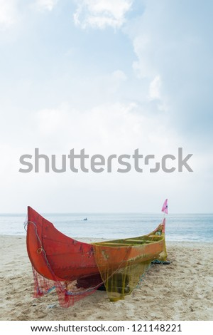 Old colorful fishing net on fishing boat in Kerala India. LAndsc - stock photo
