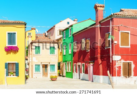 Old colorful houses in Burano, Italy. - stock photo