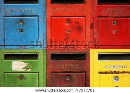 Old colorful mailboxes - stock photo