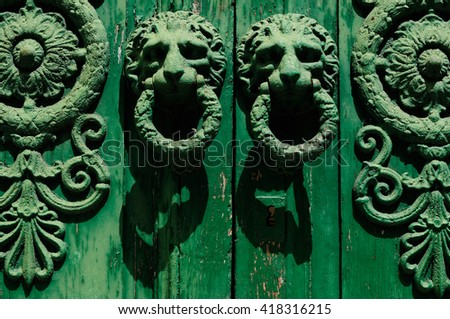 Old colourfull wooden entrance door with antique door handle