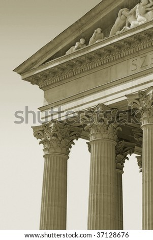 Old columns and front facade details in sepia.
