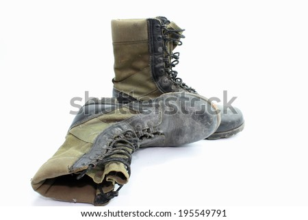 Old  combat boots isolated on white background. - stock photo