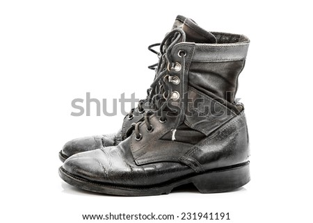 Old combat boots isolated on white background - stock photo