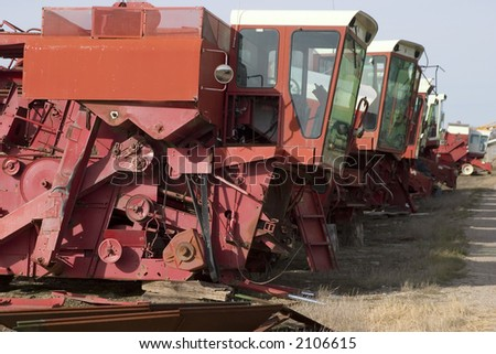 Old combine harvester graveyard - stock photo