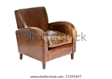Old comfy leather armchair - stock photo