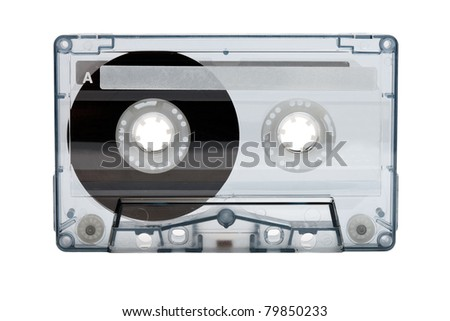 Old compact audio cassette (tape), macro shot on white background, empty - stock photo