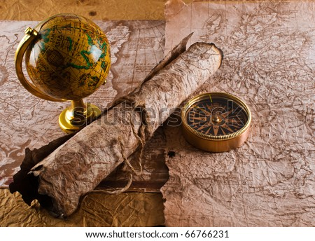 Old compass and globe  on grunge background - stock photo