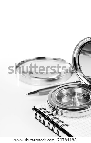 old compass and pen at notebook isolated on white background - stock photo