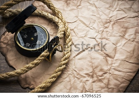old compass and rope on grunge background