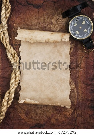 old compass and rope on grunge background - stock photo