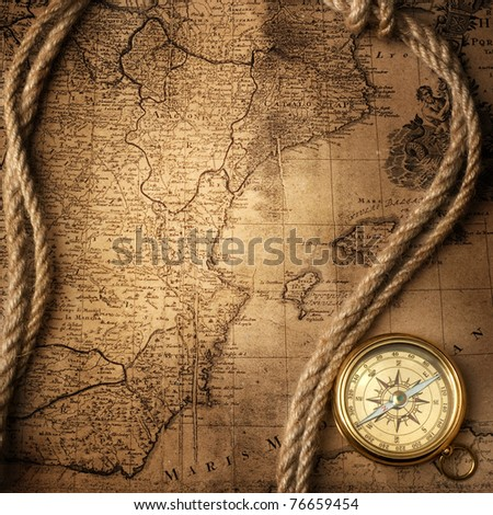 old compass and rope on vintage map - stock photo