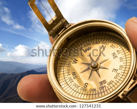 Old compass in the mountain - stock photo