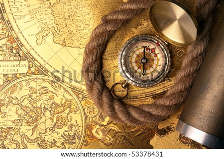 Old Compass, maps, and telescope. retro navigation instruments - stock photo