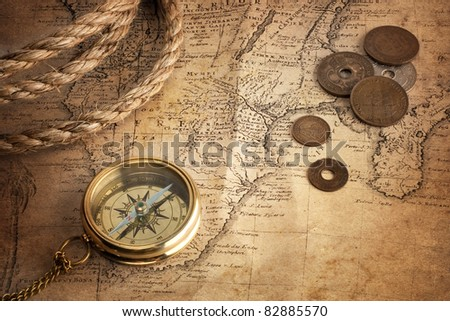 old compass, old coins and rope on vintage map ( Africa 18 century author Ion.  Matthia Hasio) - stock photo
