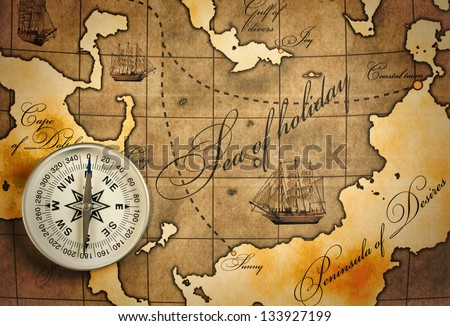 old compass on amap - stock photo