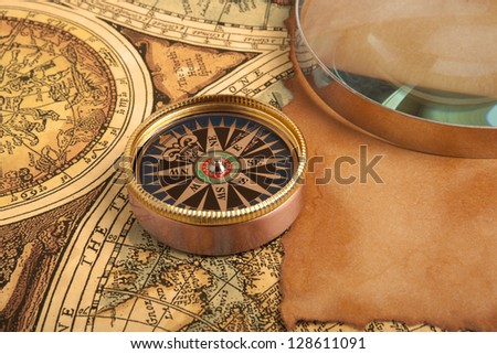 Old compass on old vintage map - stock photo