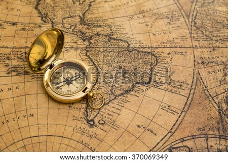 Compass On Old World Map Stock Photo 322649417