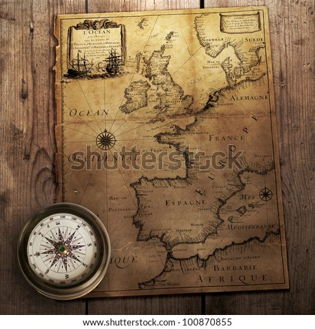 old compass on vintage map (France, Spain, England, Portugal, Holland, Denmark author Pierre Du Val (1618-1683) Paris. France 1666 ) - stock photo