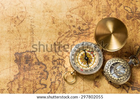 Old compass on vintage map. Retro stale - stock photo