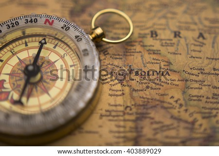 Old compass on vintage map selective focus on Bolivia