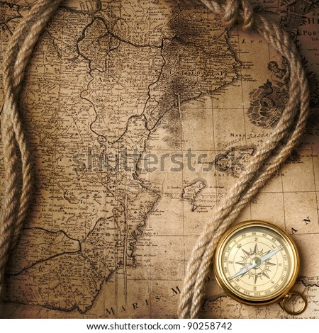 old compass on vintage map, 1732 Spain and Portugal, (author Ioh.Bapt.Homann) Nuremberg, Germany - stock photo