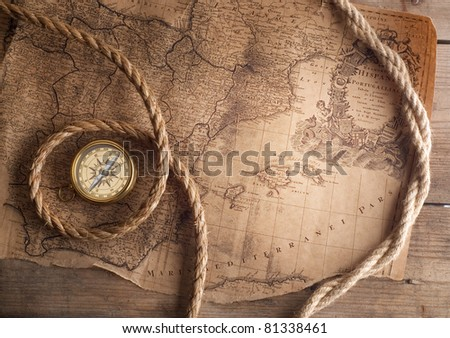 old compass on vintage map 1732 Spain and Portugal (author Ioh.Bapt.Homann) Nurenberg Germany - stock photo