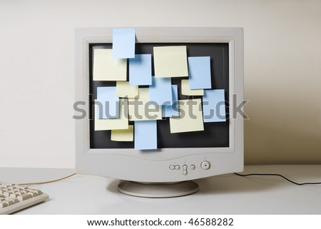old computer monitor and paper notes - stock photo
