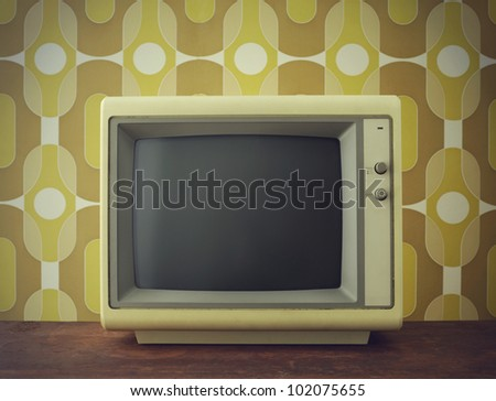 Old computer/TV screen. on vintage background - stock photo