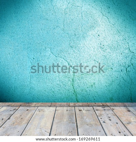 old concrete grunge wall background with wood floor
