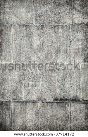 Old concrete wall covered with grey plates