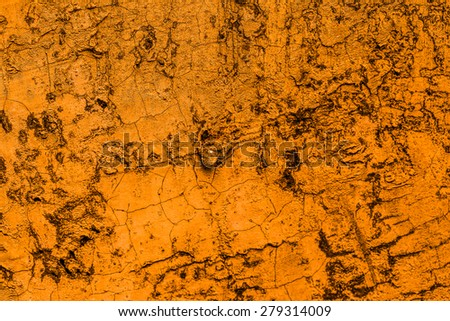 Old concrete wall orange background.