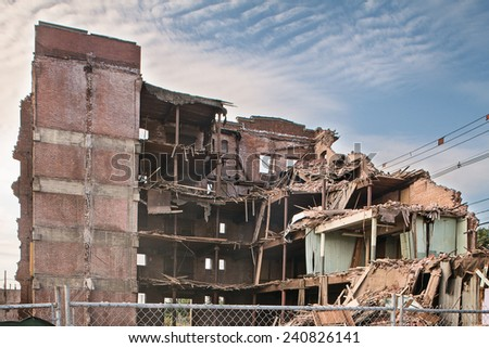 Old condemned demolished factory building  - stock photo