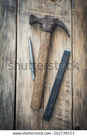 Old construction tools on a wooden table. Top view - stock photo