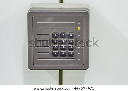 old control panel with numeric keyboard and yellow light